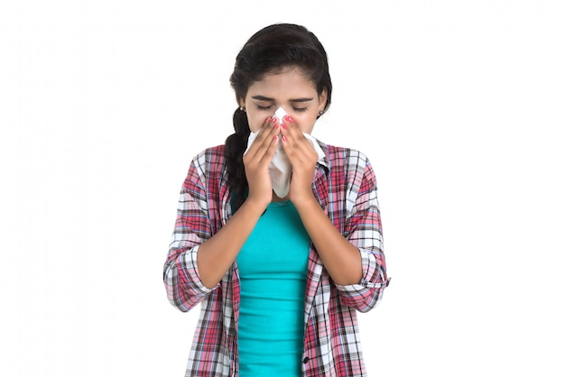 Young sick woman blowing her nose. allergic rhinitis. has fever. young woman with cold Premium Photo