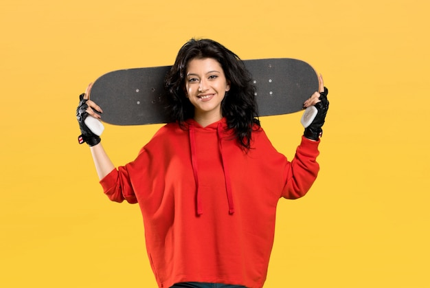 Young skater woman with red sweatshirt Premium Photo