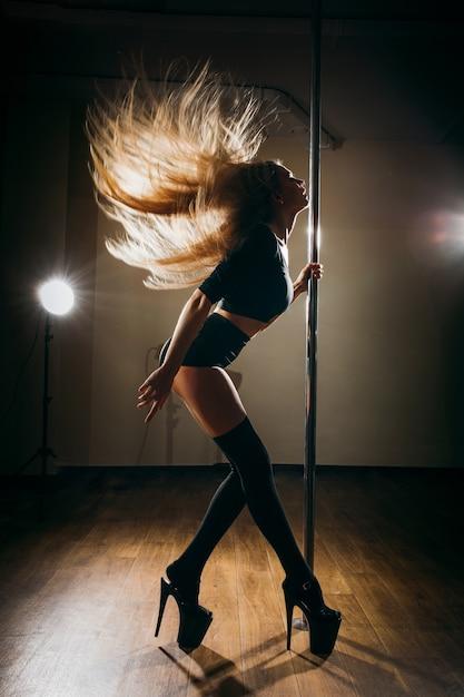 Sexy girl pole dancing