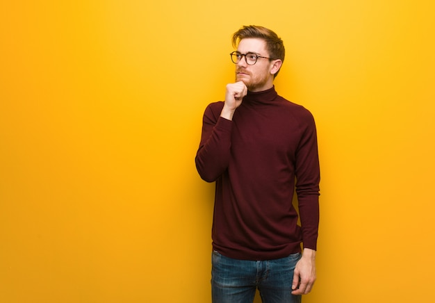 Young smart man doubting and confused Premium Photo