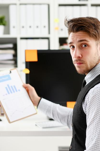 Young smile man at office workspace closeup portrait. Premium Photo
