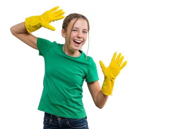 Young smiling cheerful girl in yellow rubber protective gloves Premium Photo