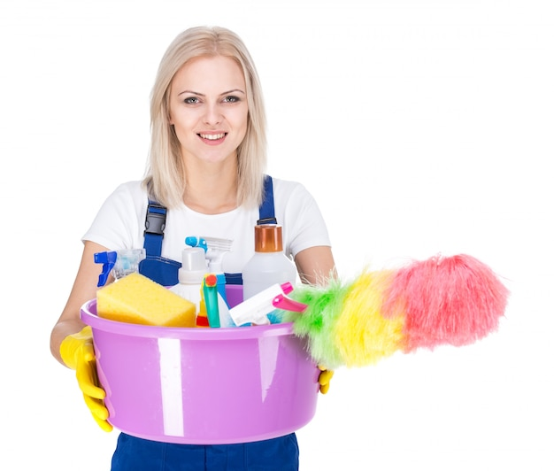 Young smiling cleaner woman on white. Premium Photo