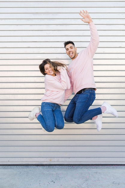 Young smiling man and attractive happy woman having fun Free Photo