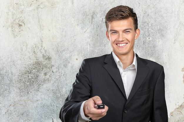 Young smiling man holding car keys Premium Photo