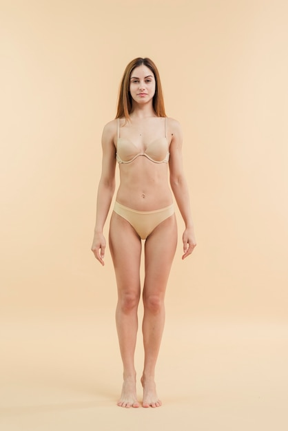 Young smiling redhead woman posing in underclothing Free Photo