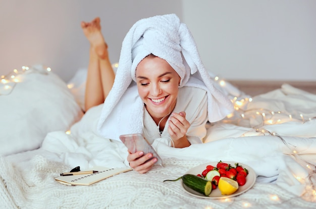 Young smiling woman enjoying her spa morning and wake up. Premium Photo