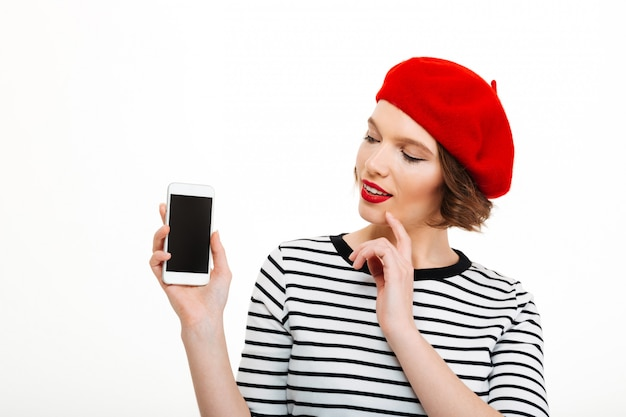 Young smiling woman showing display of mobile phone. Free Photo