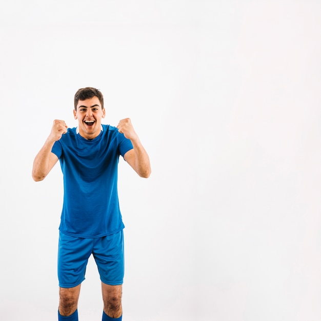 Young soccer player celebrating victory Free Photo