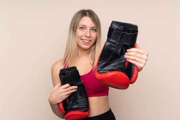 Young sport blonde woman with boxing gloves Premium Photo