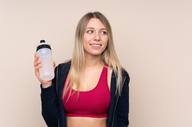 Young sport blonde woman with sports water bottle Premium Photo