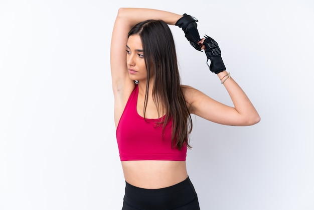 Young sport brunette woman over isolated white wall stretching Premium Photo