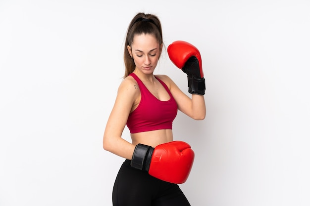 Young sport brunette woman over isolated white wall with boxing gloves Premium Photo