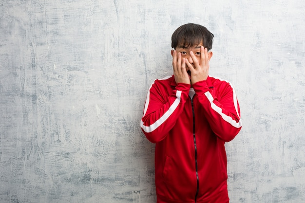 Young sport fitness chinese feels worried and scared Premium Photo