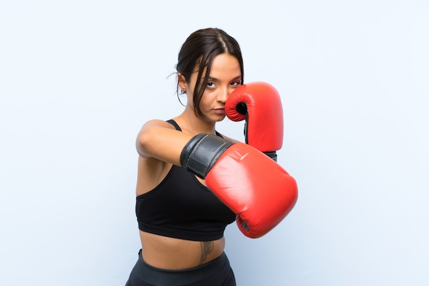 Young sport girl with boxing gloves Premium Photo
