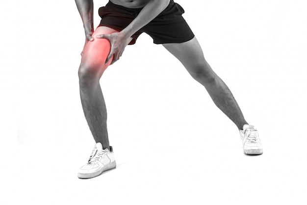 Young sport man with strong athletic legs holding knee with his hands in pain after suffering ligament injury isolated on white 1150 2943