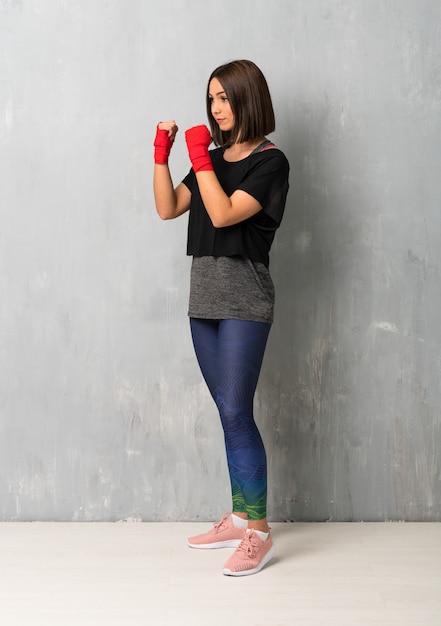 Young sport woman in boxing bandages Premium Photo