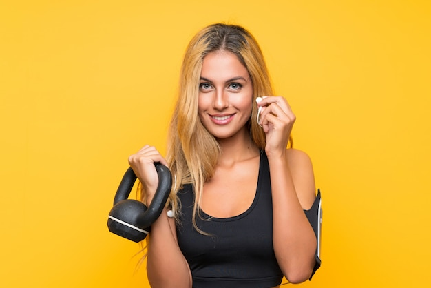 Young sport woman making weightlifting with kettlebell Premium Photo