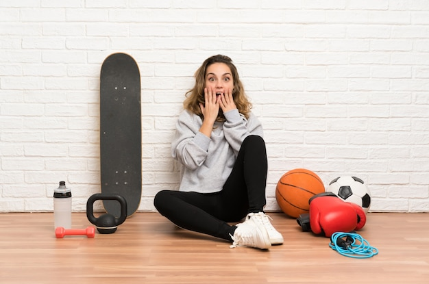 Young sport woman sitting on the floor
