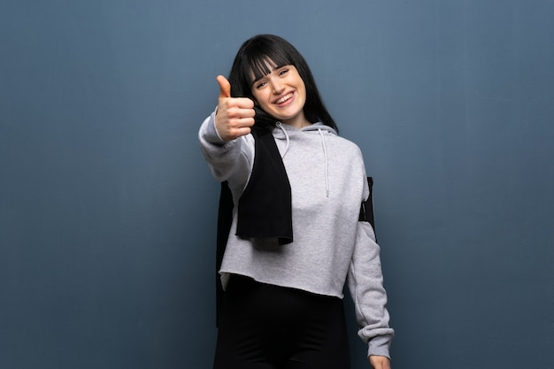 Young sport woman with thumbs up because something good has happened Premium Photo