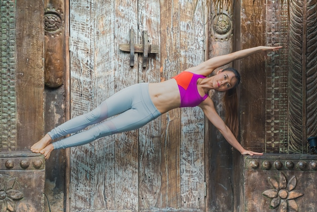 Young sport yoga woman doing exercise at home. Premium Photo