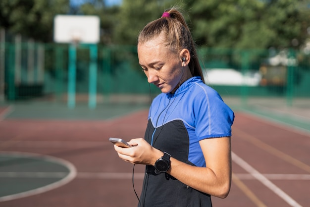 Young sportive checking mobile after training Free Photo