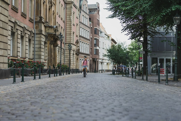 Young sports man on a bicycle in a european city. sports in urban environments. Free Photo