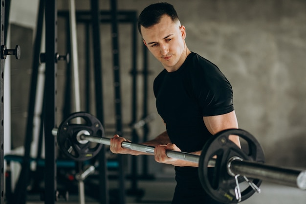 Young sports man training at the gym Free Photo