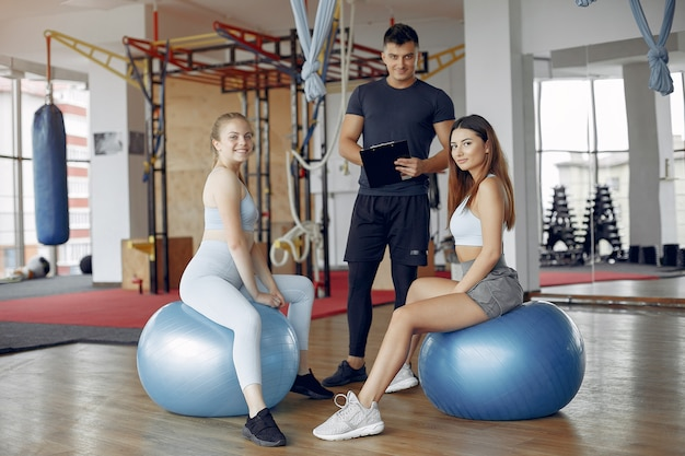 Young sports people training in a morning gym Free Photo
