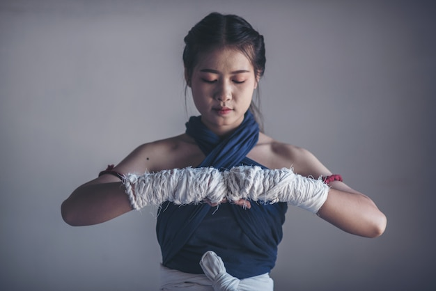 Young sports woman of boxer with white boxing bandages. Premium Photo