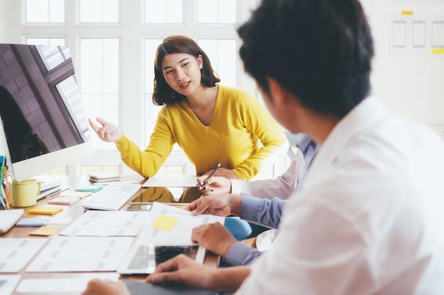 Young startups business people teamwork brainstorming meeting. Premium Photo