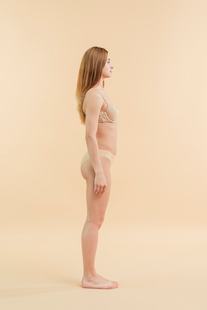 Young still woman standing in underwear Free Photo