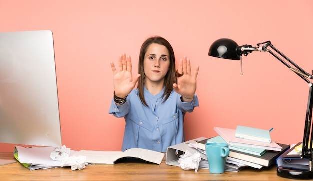 Young student girl making stop gesture and disappointed Premium Photo