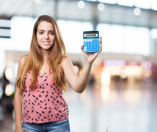 young student holdign a calculator on white background Free Photo