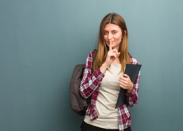 Young student russian woman keeping a secret or asking for silence Premium Photo