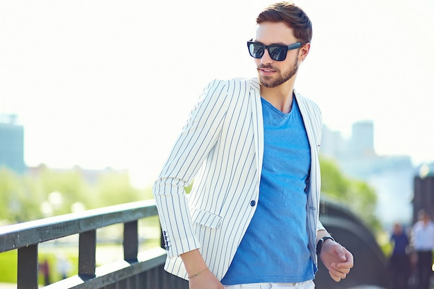 Young stylish confident happy handsome businessman model  in suit hipster cloth lifestyle in the street Free Photo
