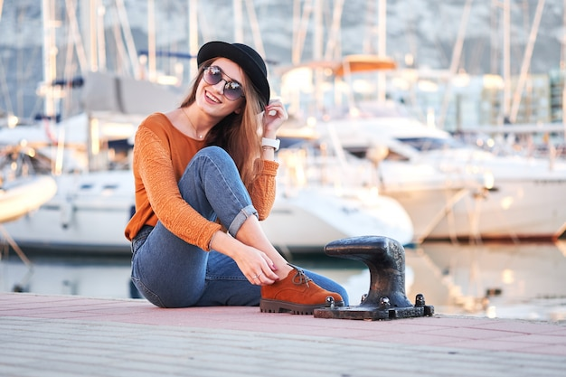 Young stylish girl in a sea port Premium Photo