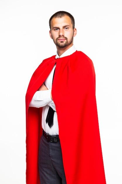 白い背景上に分離されて立っている若いスーパービジネスマン Premium写真