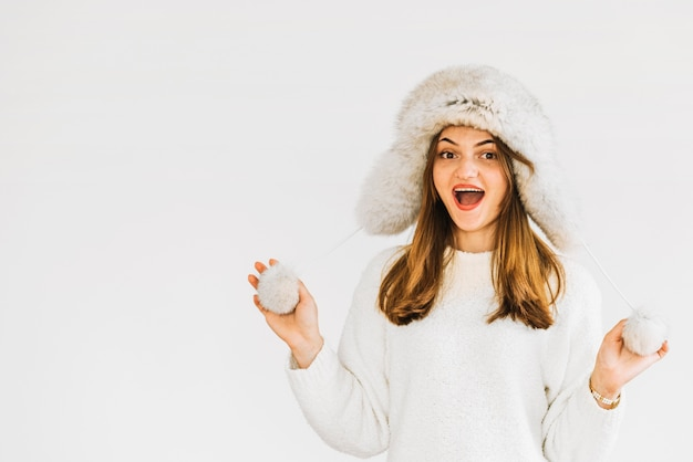 Young surprised woman in fur hat and sweater Free Photo