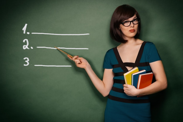 Young teacher with pointer Premium Photo