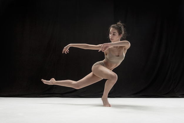 Young teen dancer on white floor. Free Photo