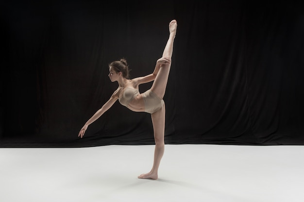 Young teen dancer on white floor Free Photo