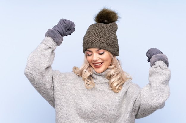 Young teenager girl with winter hat celebrating a victory Premium Photo