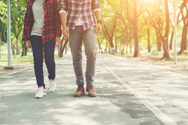 Young teenagers couple walking together in park, Relaxing holida Free Photo