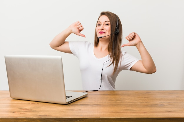 Young telemarketer woman feels proud and self confident, example to follow. Premium Photo