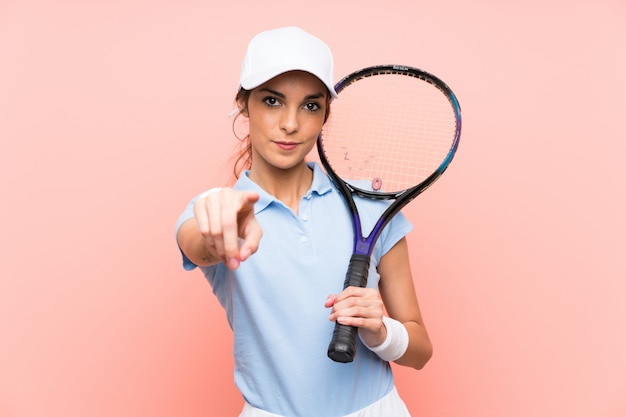 Young tennis player woman over isolated pink wall points finger at you with a confident expression Premium Photo