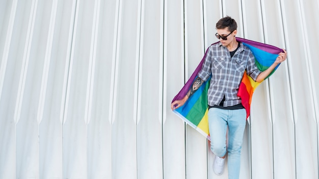 Young transgender holding lgbt flag Free Photo