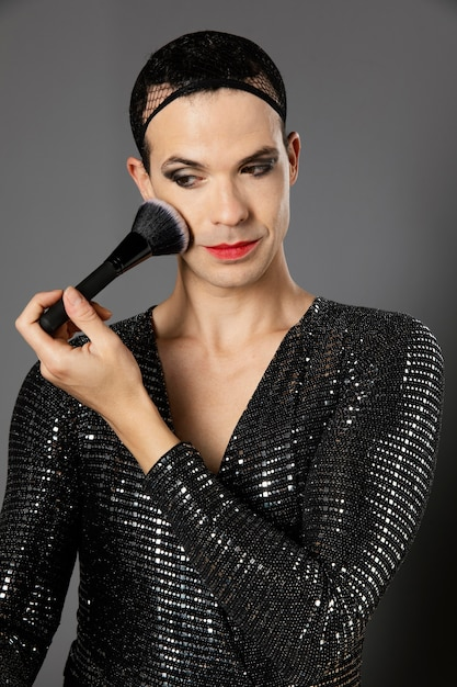 Young transgender person using a make-up brush Free Photo