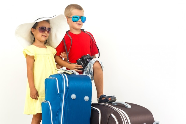The young traveler kids with a suitcase Premium Photo