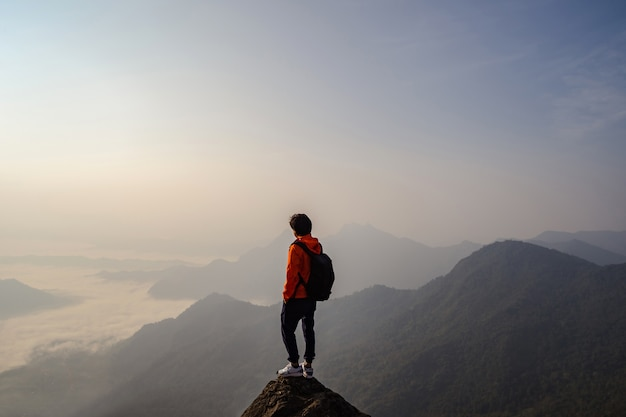 Young traveler standing and looking at beautiful landscape Premium Photo